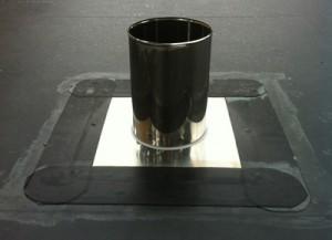 Platine de poêle sur une toiture plate en étanchéité EPDM
